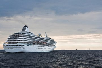Big cruise ship leaves in the sea